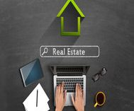 Online real estate concept on blackboard